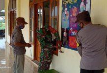 Sinergitas Babinsa dan Bhabinkamtibmas di Way Bungur Pasang Banner Imbauan Protokol Kesehatan